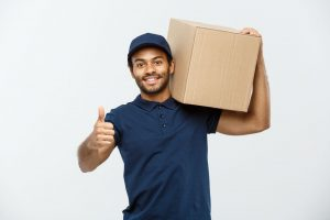 a man holding a box before starting long distnace moving