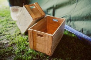 Wooden crates on grass