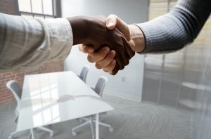 A handshake with an associate after opening your first office overseas..