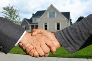 Shaking hands after buying a house in Staten Island.