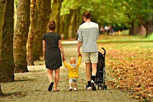 Parents walking their child.
