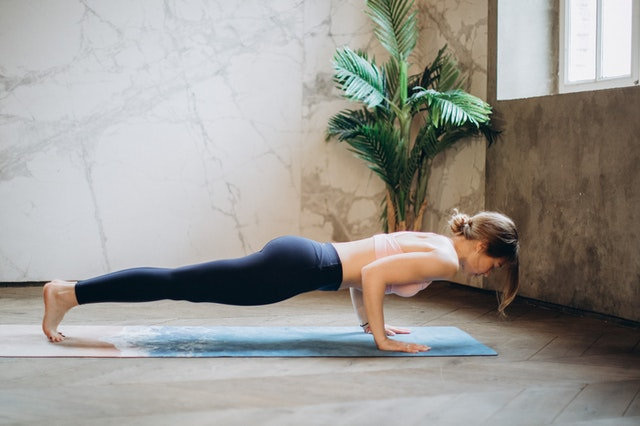 A woman having a workout at home