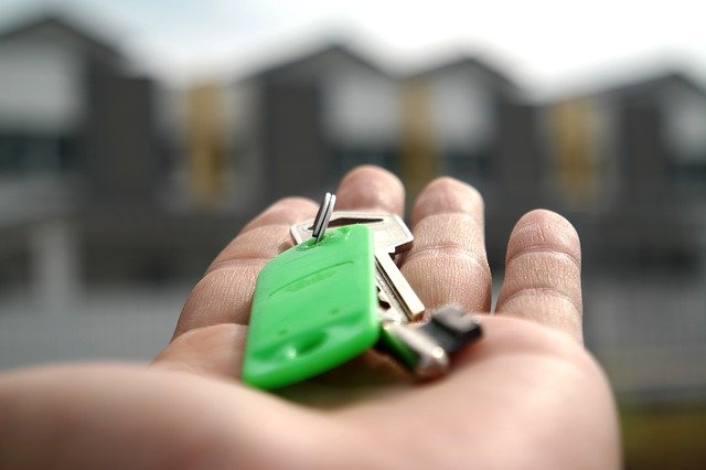 A man moving from Florida to California is holding keys to his new home.
