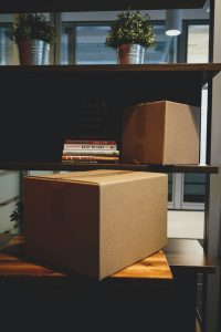 Cardboard boxes and shelving ae the best ways to store office inventory