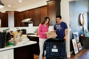 man and woman packing before moving to one of the best places for ex-pats in Orange County.