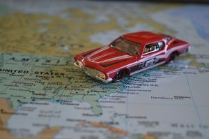 Car toy on US map.