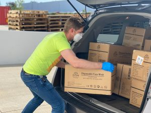 man packing boxes in the car to save money