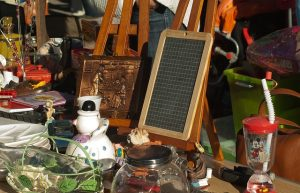 Selling belongings on a garage sale, symbolizing the first step in how to pack your garage